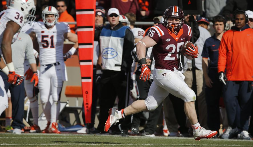 Virginia Tech fullback Sam Rogers (25) heads to the end zone for a touchdown during the first half of an NCAA college football game against Virginia in Blacksburg, Va., Saturday, Nov. 26, 2016. (AP Photo/Steve Helber)