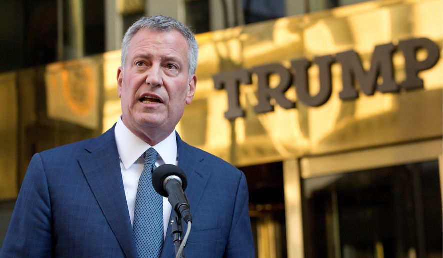 New York Mayor Bill de Blasio suggests that he will send the bill to the federal government to secure properties of President-elect Donald Trump. (Associated Press)