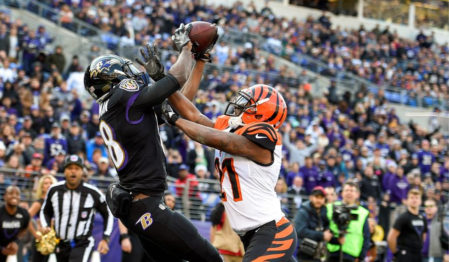 Baltimore Ravens wide receiver Breshad Perriman pulls in a 14-yard touchdown pass under pressure from Cincinnati Bengals cornerback Darqueze Dennard on the opening drive of the game on Sunday. The catch was the Ravens' lone touchdown in the 19-14 win as kicker Justin Tucker kicked four field goals and Baltimore's defense came up big. (Associated Press)