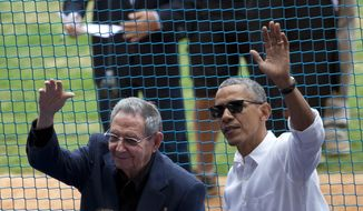 This March 22, 2016, file photo shows U.S. President Barack Obama, right, and his Cuban counterpart Raul Castro wave to cheering fans as they arrive for a baseball game between the Tampa Bay Rays and the Cuban national baseball team, in Havana, Cuba. (AP Photo/Rebecca Blackwell, File)