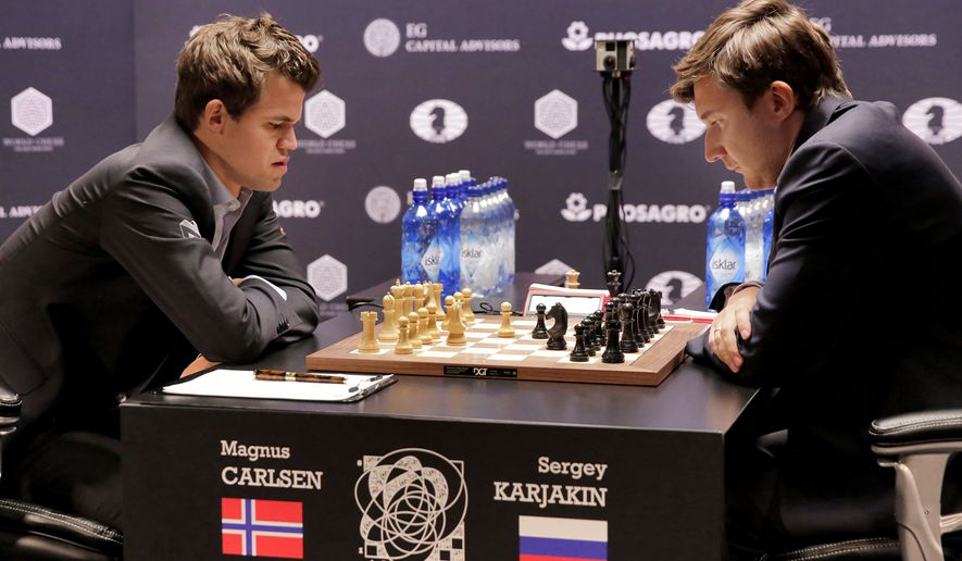 Magnus Carlsen, left, and Sergey Karjakin face off during round 8 of the World Chess Championship, in New York, Monday, Nov. 21, 2016. (AP Photo/Richard Drew)