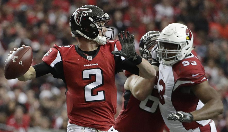 Atlanta Falcons quarterback Matt Ryan (2) works as Arizona Cardinals defensive end Calais Campbell (93) defends during the first of an NFL football game, Sunday, Nov. 27, 2016, in Atlanta. (AP Photo/David Goldman)