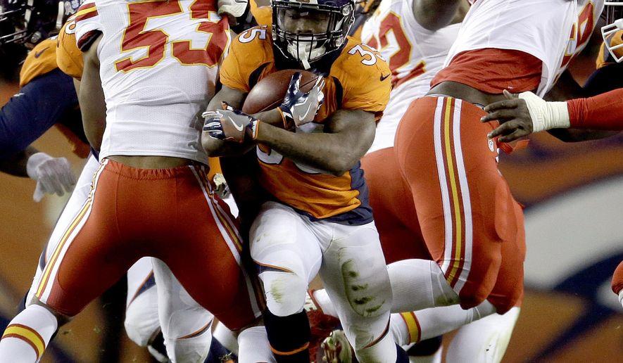 Denver Broncos running back Kapri Bibbs (35) runs the football against the Kansas City Chiefs during the first half of an NFL football game, Sunday, Nov. 27, 2016, in Denver. (AP Photo/Joe Mahoney)