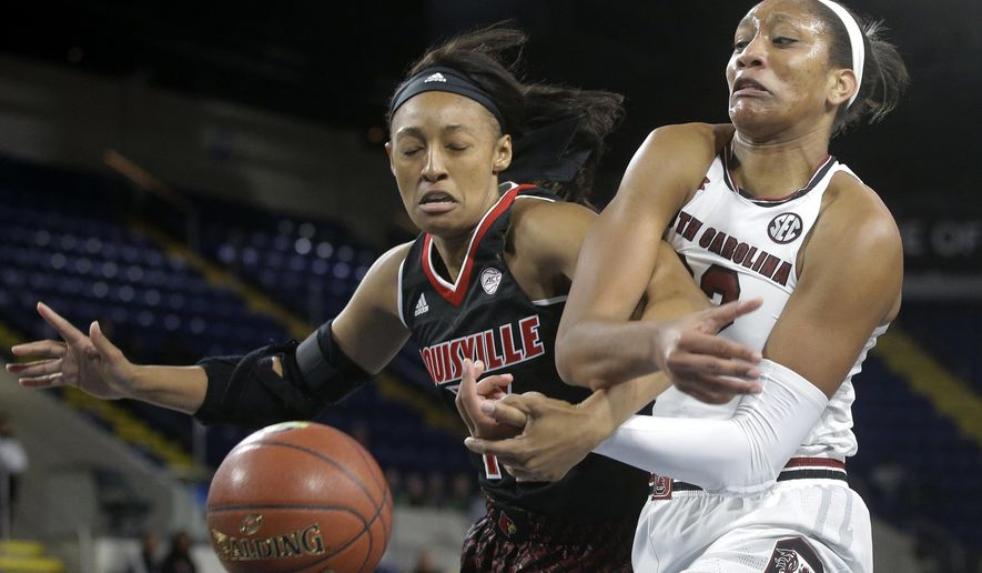 Louisville forward Cortnee Walton, left, vies for control of the ball with South Carolina forward A'ja Wilson, right, during the first half of an NCAA Naismith Memorial Basketball Hall of Fame 2016 Women's Challenge game Sunday, Nov. 27, 2016, in Springfield, Mass. (AP Photo/Steven Senne)