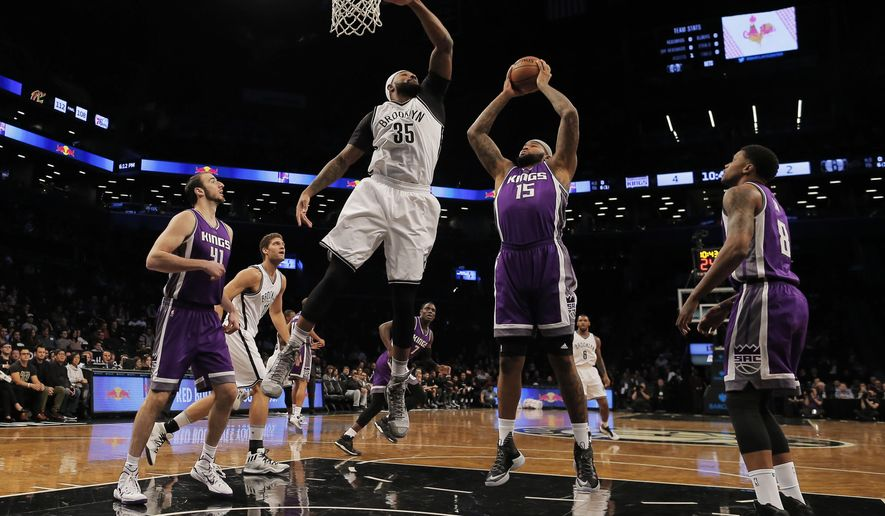 Sacramento Kings' DeMarcus Cousins (15) and Brooklyn Nets' Trevor Booker (35) fight for the rebound during an NBA basketball game in New York, Sunday, Nov. 27, 2016. (Photo/Andres Kudacki)