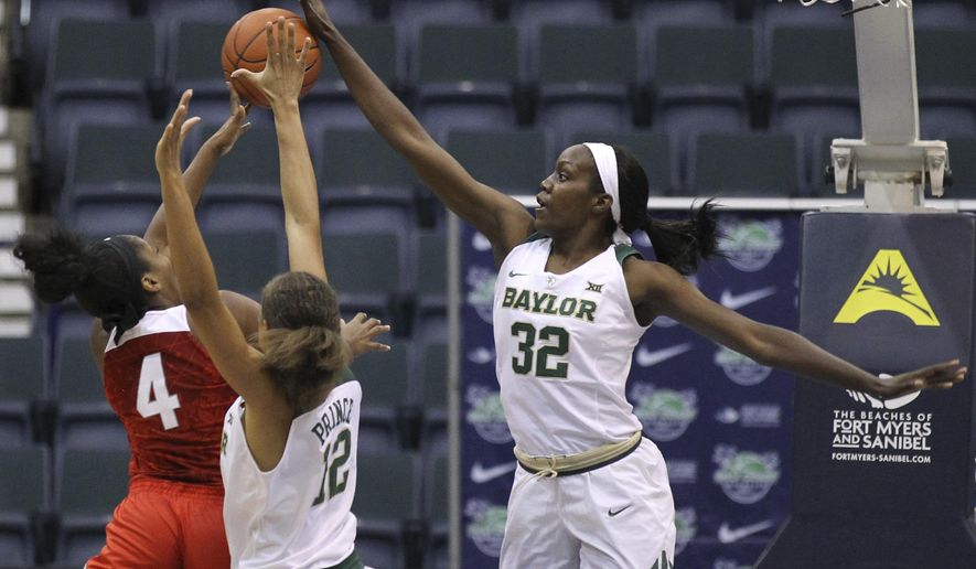 Baylor's Beatrice Mompremier (32) blocks a shot by Ohio State's Sierra Calhoun (4) as Baylor's Alexis Prince (12) defends during the first half of an NCAA college basketball game at the Gulf Coast Showcase basketball tournament Sunday, Nov. 27, 2016, in Estero, Fla. (AP Photo/Luis M. Alvarez)