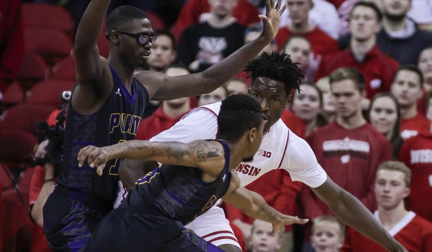 Wisconsin's Nigel Hayes, behind, dribbles against Prairie View A&M's JD Wallace, left, and Daquan Cook during the first half of an NCAA college basketball game Sunday, Nov. 27, 2016, in Madison, Wis. (AP Photo/Andy Manis)
