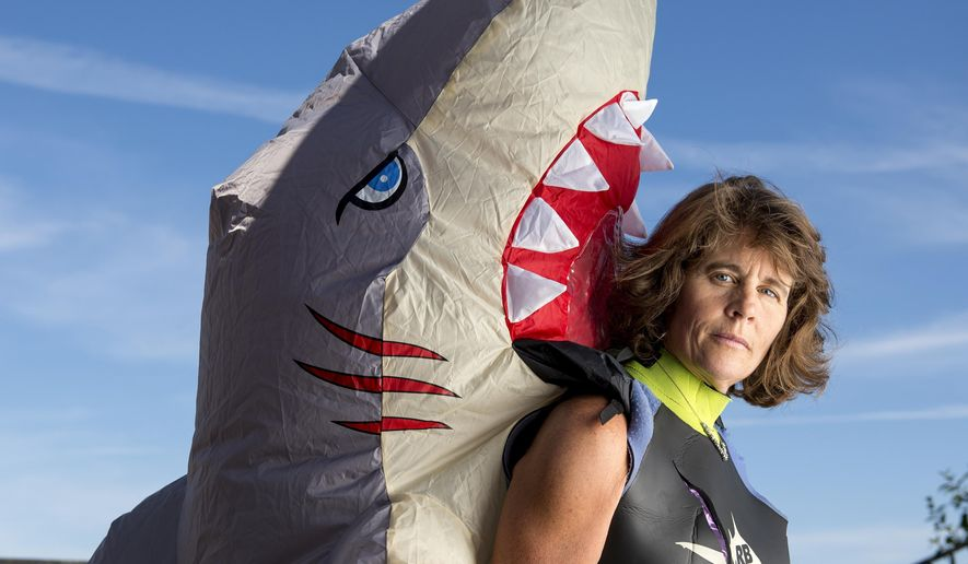 Shark attack survivor Maria Korcsmaros wears a Halloween shark costume at her home in Corona on Wednesday, Nov. 23, 2016.  Korcsmaros has become an advocate to stop the worldwide trade of shark fins.  (Leonard Ortiz/The Orange County Register via AP)