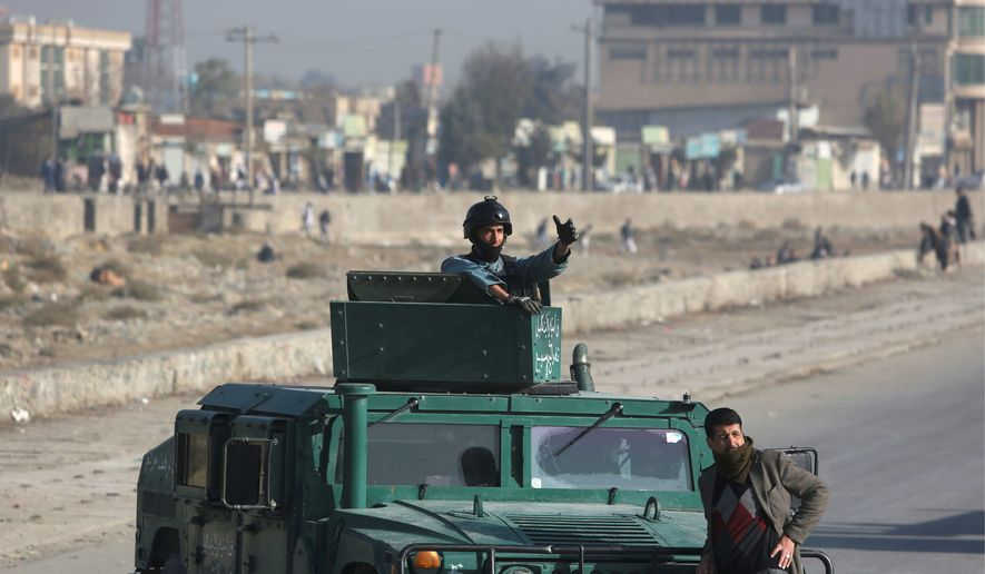 Afghan security forces inspect the site of a suicide attack in Kabul on Nov. 16, just one in a series of attacks by Taliban insurgents and Islamic State fighters over the past two months. (Associated Press)
