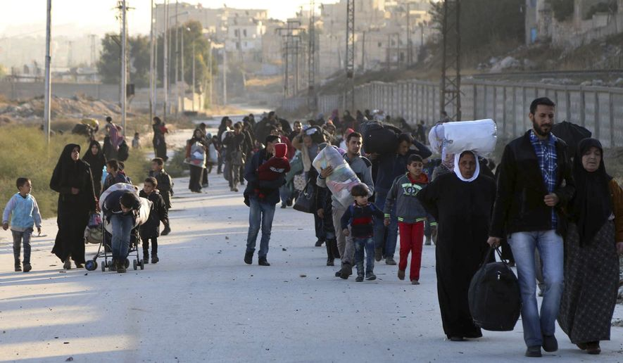 This Sunday, Nov. 27, 2016, photo provided by the Rumaf, a Syrian Kurdish activist group, which has been authenticated based on its contents and other AP reporting, shows people fleeing rebel-held eastern neighborhoods of Aleppo into the Sheikh Maqsoud area that is controlled by Kurdish fighters, Syria. Syrian state media is reporting that government forces have captured the eastern Aleppo neighborhood of Sakhour, putting much of the northern part of Aleppo's besieged rebel-held areas under state control. (The Rumaf via AP)