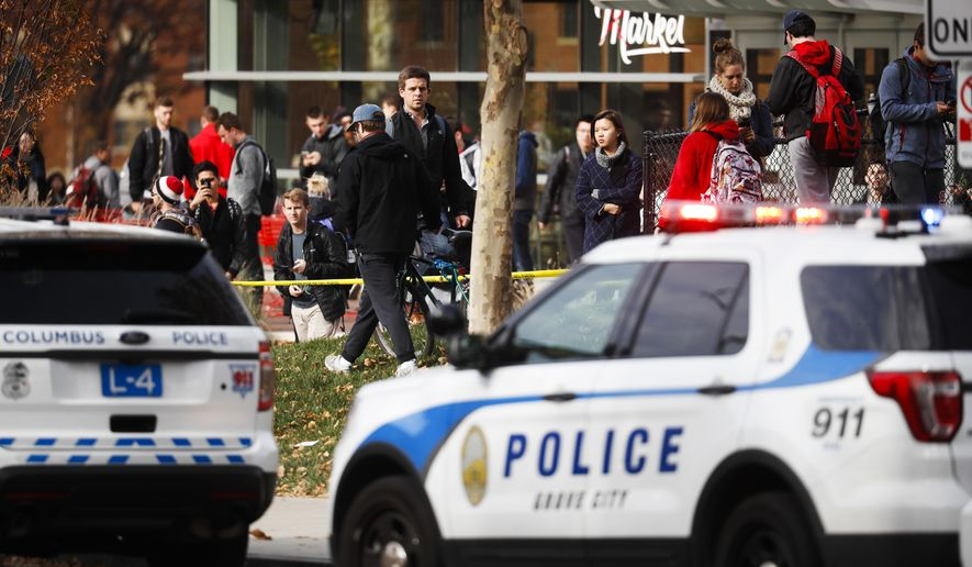 CORRECTS CITY TO COLUMBUS, INSTEAD OF CINCINNATI - Students leave buildings surrounding Watts Hall as police respond to reports of a shooting on campus at Ohio State University, Monday, Nov. 28, 2016, in Columbus, Ohio. (AP Photo/John Minchillo)