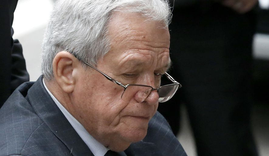 FILE - In this April 27, 2016, file photo, former House Speaker Dennis Hastert departs the federal courthouse in Chicago. Hastert, is behind bars in a hush-money case that stemmed from his sexual abuse of students when he taught and coached at an Illinois school over 35 years ago. Already hit financially by his prosecution and conviction he is now pointing to a technicality to argue that a state body should restore the $17,000 pension it yanked within hours of his April 27, 2016 sentencing. (AP Photo/Charles Rex Arbogast, File)