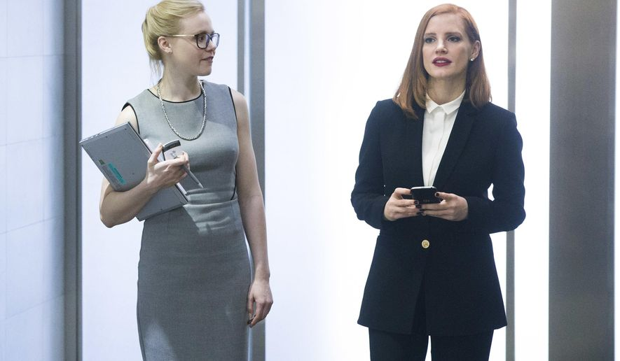 "This image released by Europa shows Alison Pill, left, and Jessica Chastain in a scene from, ""Miss Sloane.""  (Kerry Hayes/Europa via AP)"