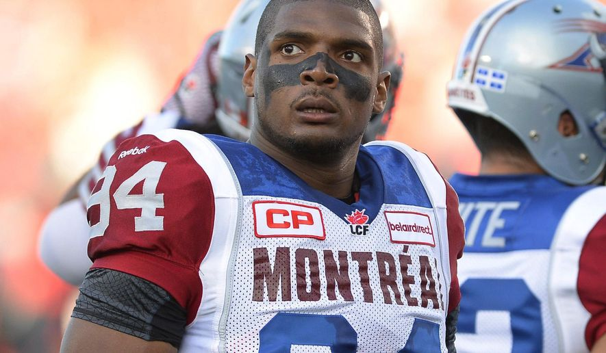 FILE - In this Aug. 7, 2014, file photo, Montreal Alouettes' Michael Sam and teammates warm up for a Canadian Football League game against the Ottawa Redblacks in Ottawa, Ontario. The first openly gay player to be drafted by an NFL team is heading to Massachusetts to talk about his life. Sam is scheduled to deliver a lecture at Clark University in Worcester on Tuesday, Nov. 29, 2016. (Justin Tang/The Canadian Press via AP, File)