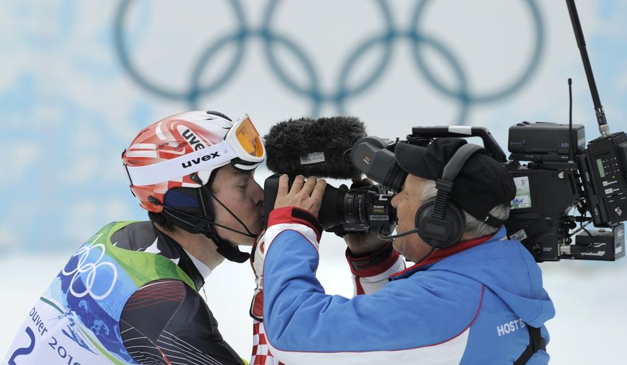 FILE - In this Feb. 27, 2010 file photo Croatia's Ivica Kostelic kisses a TV camera as he reacts after finishing the second run of the Men's slalom, at the Vancouver 2010 Olympics in Whistler, British Columbia. Eurosport will have exclusive broadcast rights in Germany for the next four Olympics, leaving public broadcasters ARD and ZDF shut out, Eurosport announced Monday Nov. 28, 2016.  (AP Photo/Gero Breloer)