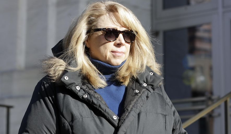 Diane Backis leaves the federal courthouse on Monday, Nov. 28, 2016, in Albany, N.Y. Backis, an accountant, has admitted stealing at least $3.1 million from a Minnesota-based grain shipping company she worked for at the Port of Albany. Backis, of Athens, N.Y., pleaded guilty Monday to mail fraud and filing a false income tax return. U.S. Attorney Richard Hartunian says Backis not only stole from Cargill, Inc., but caused at least $25 million in losses to the Minnetonka, Minnesota-based company by manipulating customer invoices and payments. (AP Photo/Mike Groll)