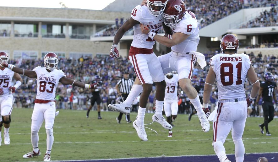 FILE - In this Oct. 1, 2016, file photo, Oklahoma wide receiver Dede Westbrook (11) celebrates catching a touchdown pass with quarterback Baker Mayfield (6) as wide receiver Mark Andrews (81) looks on during the first half of an NCAA college football game against TCU, in Fort Worth, Texas. The Oklahoma Sooners have two Heisman contenders in quarterback Baker Mayfield and receiver Dede Westbrook. (AP Photo/LM Otero, File)