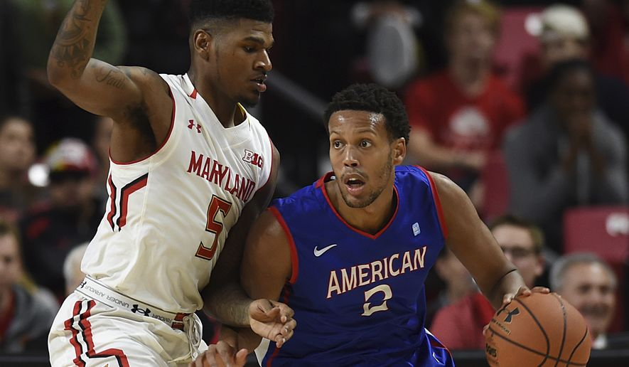 Maryland's Dion Wiley, left, defends as American's Delante Jones drives to the basket during the first half of an NCAA college basketball game, Nov. 11, 2016, in College Park, Md. (AP Photo/Gail Burton) **FILE**