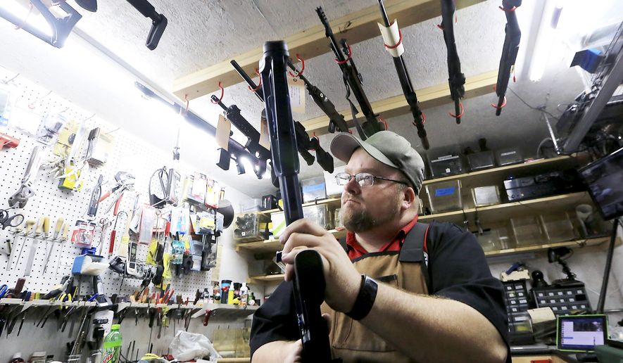 Gun Shop Project participant Chuck Lovelace, owner of Essential Shooting Supplies in Mount Horeb, Wis., appears in his store on Nov. 7, 2016. The program also encourages gun shop customers to store firearms away from home if a household member is having a mental health crisis. (John Hart/Wisconsin State Journal via AP) **FILE**