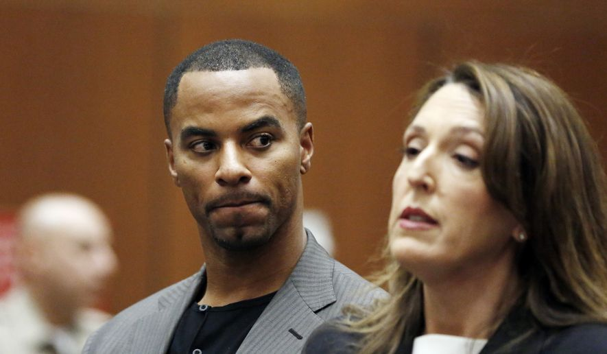 FILE - In this Feb. 20, 2014, file photo, Darren Sharper looks toward his attorney, Blair Berk, during an appearance in Los Angeles Superior Court in Los Angeles. The former NFL football star's tour of shame and punishment reached its conclusion in the Los Angeles courtroom where he first admitted drugging and raping women in several states. Sharper was sentenced Tuesday, Nov. 29, 2016 to 20 years in prison, but under terms that would total about half that time in custody. However, he's been sentenced in a Louisiana federal court to 18 years. (AP Photo/Mario Anzuoni, Pool, File) **FILE**