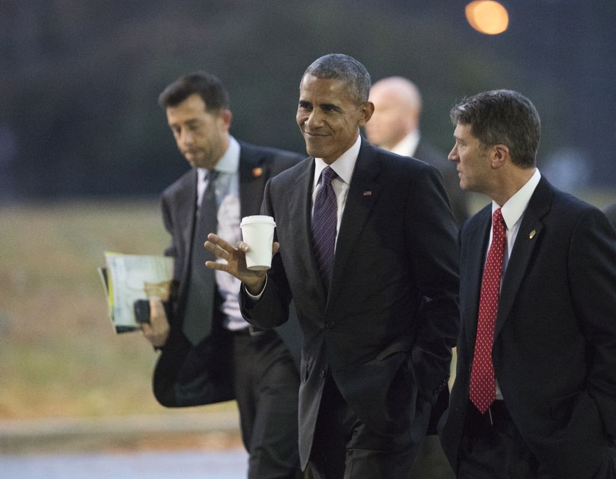 President Barack Obama walks with his physician Ronny Jackson, right, towards a waiting Marine One as he leaves Walter Reed National Military Medical Center in Bethesda, Md., after visiting wounded service members, Tuesday, Nov. 29, 2016. During the president's visit he met with 13 Army service members and awarded 12 Purple Hearts. (AP Photo/Manuel Balce Ceneta)