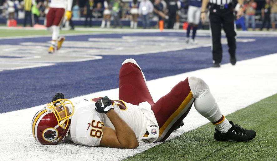 Washington Redskins' Jordan Reed lays on the ground after suffering an unknown injury during an NFL football game against the Dallas Cowboys on Thursday, Nov. 24, 2016, in Arlington, Texas. (AP Photo/Michael Ainsworth)