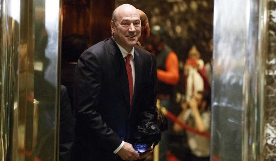 Goldman Sachs COO Gary Cohn gets on an elevator for a meeting with then-President-elect Donald Trump at Trump Tower, Tuesday, Nov. 29, 2016, in New York. (AP Photo/Evan Vucci) ** FILE **