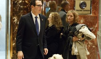 Steven Mnuchin, national finance chairman of President-elect Donald Trump's campaign, walks to lunch at Trump Tower, Tuesday, Nov. 29, 2016, in New York. (AP Photo/Evan Vucci)