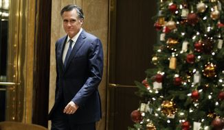 Former Republican presidential nominee Mitt Romney arrives to talk with reporters after eating dinner with President-elect Donald Trump at Jean-Georges restaurant, Tuesday, Nov. 29, 2016, in New York. (AP Photo/Evan Vucci)