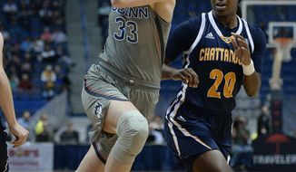 Connecticut's Katie Lou Samuelson, left, drives around Chattanooga's Keiana Gilbert, right, in the first half of an NCAA college basketball game, Tuesday, Nov. 29, 2016, in Hartford, Conn. (AP Photo/Jessica Hill)