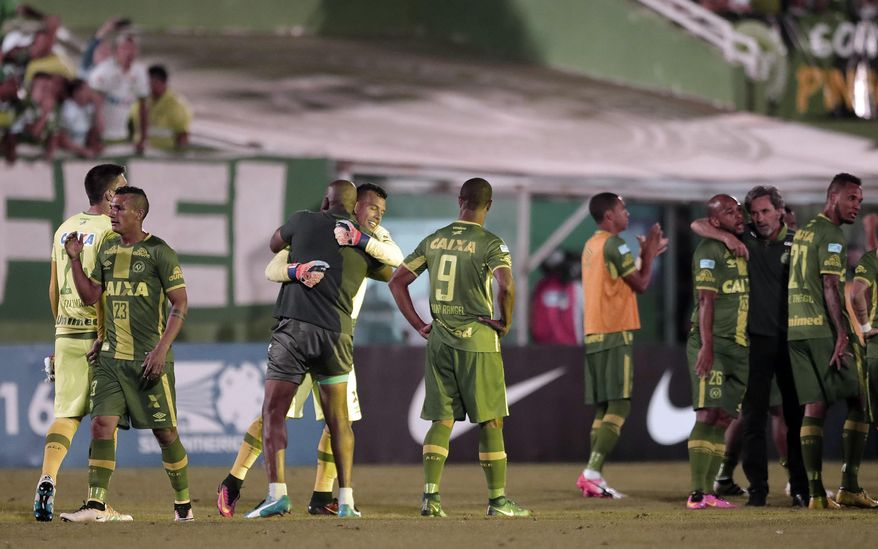 In this Wednesday, Nov. 23, 2016, file photo, players of Brazil's Chapecoense celebrate at the end of a Copa Sudamericana semifinal soccer match against Argentina's San Lorenzo in Chapeco, Brazil. A chartered aircraft with 81 people on board, including the Brazilian first division Chapecoense soccer team heading to Colombia for a regional tournament final, has crashed on its way to Medellin's international airport. (AP Photo/Andre Penner, File )