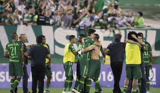 CORRECTS TO DELETE THE NUMBER OF PASSENGERS - In this Wednesday, Nov. 23, 2016, file photo, players of Brazil's Chapecoense celebrate at the end of a Copa Sudamericana semifinal soccer match against Argentina's San Lorenzo in Chapeco, Brazil. A chartered aircraft with passengers including players from Chapecoense, heading to Colombia for a regional tournament final, has crashed on its way to Medellin's international airport in Colombia, Medellin's Mayor Federico Gutierrez and Medellin's airport said Tuesday, Nov. 29. (AP Photo/Andre Penner, File)