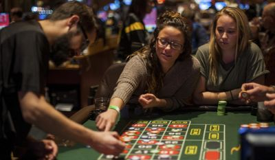 In this Nov. 17, 2016 photo, Ashley Koletta, 23, of Mt. Washington, and Olivia Kluiter, 24, of Greensburg, play roulette at Rivers Casino on the North Shore, in Pittsburgh. (Nate Smallwood  /Pittsburgh Tribune-Review via AP)