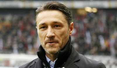 FILE - In this  Nov. 26, 2016 file picture Frankfurt Croatian  coach Niko Kovac attends the Bundesliga soccer match between Eintracht Frankfurt and Borussia Dortmund in Frankfurt, Germany.   Kovac , who took over as coach last March when Frankfurt was in the relegation zone, has revitalized the unheralded club, guiding it through a relegation playoff and quietly steering the side to fourth place in the league, its best start in 23 years. (Ronald Wittek/dpa via AP,file)