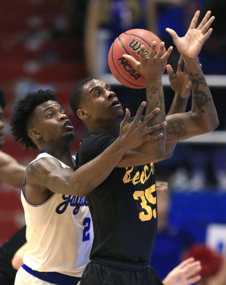 Long Beach State forward Javonntie Jackson (35) handles a pass while covered by Kansas guard Lagerald Vick (2) during the first half of an NCAA college basketball game in Lawrence, Kan., Tuesday, Nov. 29, 2016. (AP Photo/Orlin Wagner)