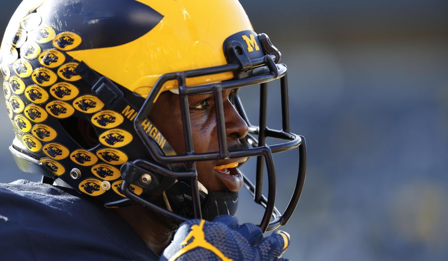 FILE - In this Nov. 5, 2016, file photo, Michigan Wolverines linebacker Jabrill Peppers (5) watches during an NCAA college football game against Maryland, in Ann Arbor, Mich. The numbers strongly suggest they are two of the four, maybe five, best teams in the country, but after Saturday one of either No. 3 Michigan or No. 2 Ohio State will be on the outside looking  in at the College Football Playoff race. (AP Photo/Paul Sancya, File)