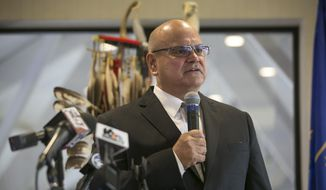 John Warren, chairman of the Pokagon Band of Potawatomi Indians, speaks during a press conference on Tuesday Nov. 29, 2016, announcing the federal government placing nearly 166 acres of land in South Bend, Ind., into trust for a tribal village and a casino that is expected to be the largest in Indiana. (Santiago Flores/South Bend Tribune via AP)