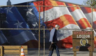 A man walks outside of the American Legion Hall, which served a free Thanksgiving dinner, in Antioch, Calif., Tuesday, Nov. 29, 2016. (AP Photo/Jeff Chiu)