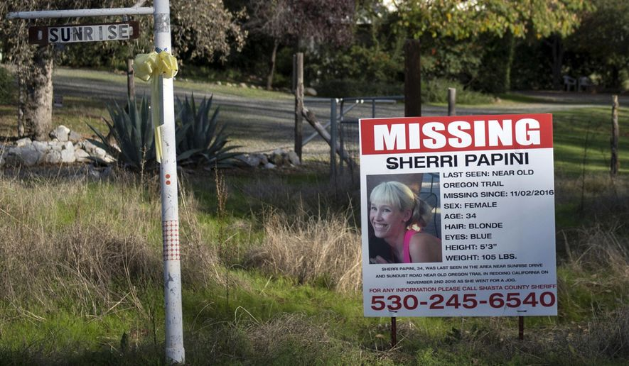 """FILE - In this Nov. 10, 2016 file photo, a """"missing"""" sign for Mountain Gate, Calif., resident Sherri Papini, 34, is placed along side Sunrise Drive, near the location where the mom of two is believed to have gone missing while on a afternoon jog on Nov. 2. Papini was chained to an object and had been badly beaten when found near an interstate three weeks after she disappeared while jogging, according to a newspaper citing a police-dispatch recording. (Andrew Seng/The Sacramento Bee via AP, File)"""