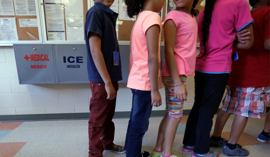 Detained children line up in the cafeteria at the Karnes County Residential Center, a temporary home for illegal immigrant women and children in Texas. (Associated Press)
