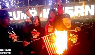 Protesters burn American flags outside Trump Tower in New York City on Tuesday, Nov. 29, 2016. (Image: Twitter, Sunsara Taylor)