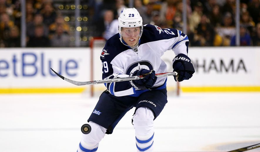 Winnipeg Jets right wing Patrik Laine during the third period of the Boston Bruins 4-1 win over the Winnipeg Jets in an NHL hockey game in Boston Saturday, Nov. 19, 2016. (AP Photo/Winslow Townson)