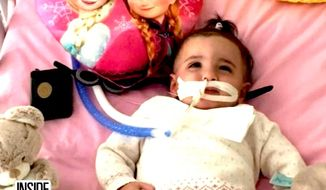 Marwa Bouchenafa, 1, from Marseilles, France, was placed in a medically induced coma after coming down with a virus. She came out of the coma as a medical team was preparing to take her off life support in September. (Inside Edition screenshot)