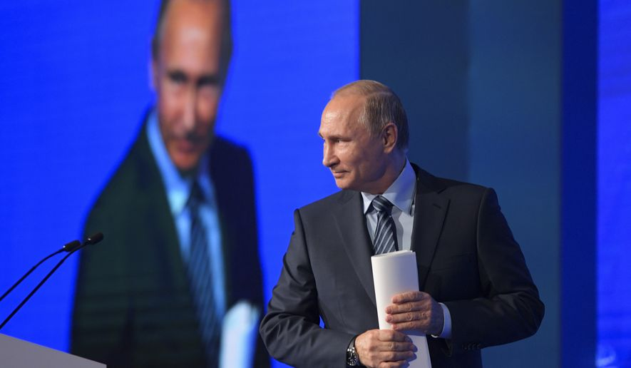Russian President Vladimir Putin walks to address a forum in Moscow, Russia on Wednesday, Nov. 30, 2016. Putin attended an international forum dedicated to former Prime Minister Yevgeny Primakov. (Alexei Druzhinin/Sputnik, Kremlin Pool Photo via AP)