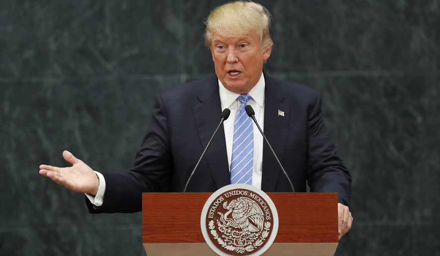 FILE - In this Wednesday, Aug. 31, 2016, file photo, Republican presidential candidate Donald Trump speaks during a joint statement with Mexico's President Enrique Pena Nieto in Mexico City. American consumers and businesses would pay, literally, if President-elect Trump follows through on his campaign pledge to slap big taxes on imports from China and Mexico. (AP Photo/Dario Lopez-Mills, File)