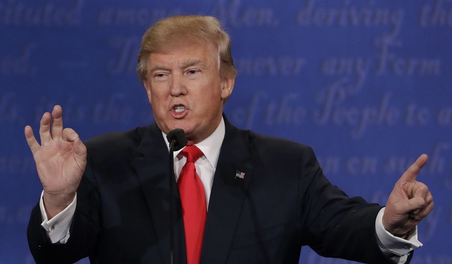 In this Oct. 19, 2016, file photo, Republican presidential nominee Donald Trump speaks during the third presidential debate with Democratic presidential nominee Hillary Clinton at UNLV in Las Vegas. (AP Photo/David Goldman, File)