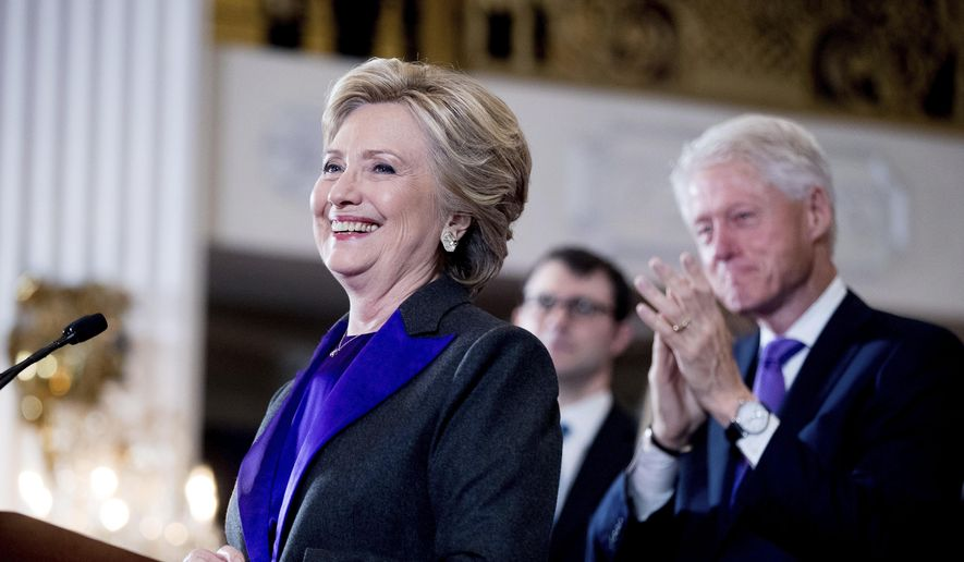 In this Nov. 9, 2016, file photo, Hillary Clinton, accompanied by former President Bill Clinton, right, pauses while speaking to staff and supporters at the New Yorker Hotel in New York. Hillary Clinton introduced singer and UNICEF Goodwill Ambassador Katy Perry on Tuesday, Nov. 29, at the annual event in New York. (AP Photo/Andrew Harnik, File)