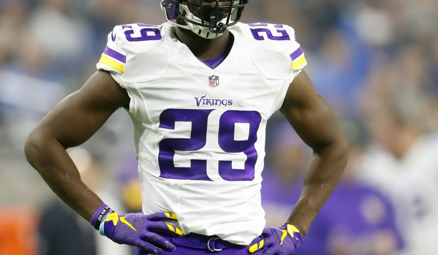FILE - In this Thursday, Nov. 24, 2016 file photo, Minnesota Vikings cornerback Xavier Rhodes stands during the second half of an NFL football game against the Detroit Lions in Detroit. The Vikings play the Dallas Cowboys on Thursday, Dec. 1, 2016. (AP Photo/Paul Sancya, File)