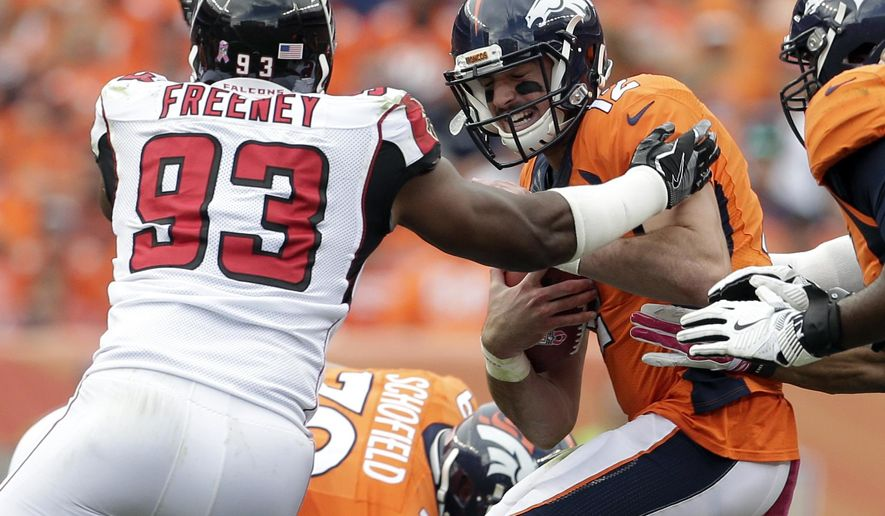 FILE - In this Oct. 9, 2016, file photo, Denver Broncos quarterback Paxton Lynch (12) is hit by Atlanta Falcons defensive end Dwight Freeney (93) during the second half of an NFL football game, in Denver. The Falcons' defense has new concerns after placing cornerback Desmond Trufant on injured reserve and also losing defensive end Adrian Clayborn to an injury. (AP Photo/Joe Mahoney, File)