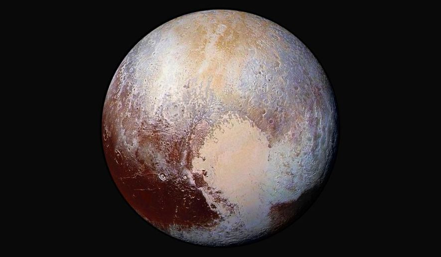 This image made available by NASA on July 24, 2015 shows a combination of images captured by the New Horizons spacecraft with enhanced colors to show differences in the composition and texture of Pluto's surface. The deep icy basin in Pluto's heart-shaped region may be a natural sinkhole. In a study published Wednesday, Nov. 30, 2016, a team led by University of Maryland astronomer Douglas Hamilton suggests the basin may have resulted from the weight of surface ice. (NASA/JHUAPL/SwRI via AP) **FILE**